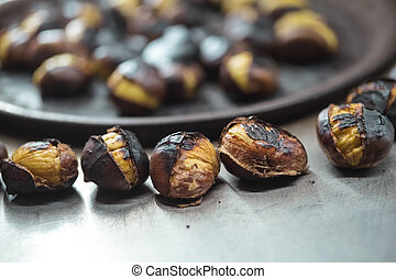Group of roasted chestnuts for sale on the street - Close up...
