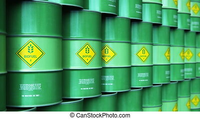 Group of rows of green stacked biofuel drums in storage...