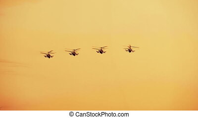 Group of russian combat helicopters K-52, red warm sunset -...