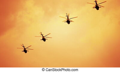 Group of russian combat helicopters on red hot warm sunset