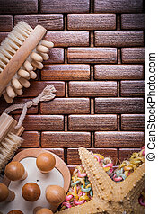 Group of sauna accessories on textured wooden place mat vertical