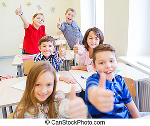 group of school kids showing thumbs up - education,...