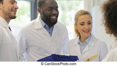 Group Of Scientist Happy Smiling Walk In Laboratory After Analyzing Chemicals Test Tube Results Of Research Experiment