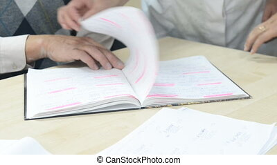 Group of scientists discussing experiment notes - Group of...