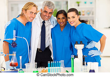 group of scientists - group of smiling scientists team in...