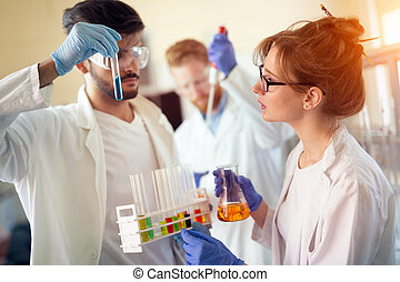 Group of scientists working at laboratory