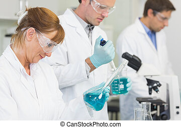 Group of scientists working at the