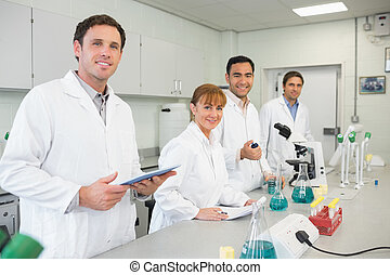 Group of scientists working in the