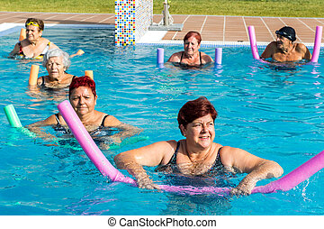 Group of senior citizens doing aqua gym.t