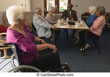 Group of senior friends having fun at nursing home