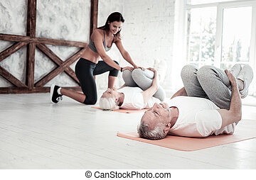 Group of senior people attending fitness club