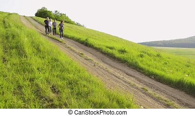 Group of seniors running in nature on dirt road. - Group of...