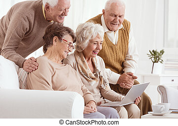 Group of seniors using laptop