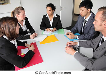 Group of serious business people in a meeting