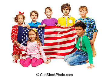 Group of seven kids holding American flag