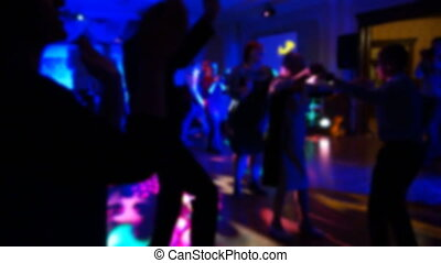 Group of silhouetted people dancing
