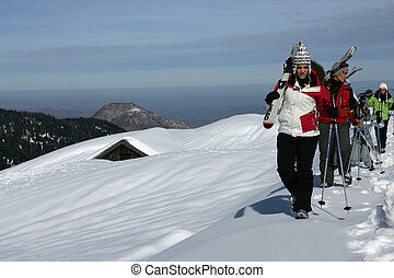 Group of skiers walking through the snow