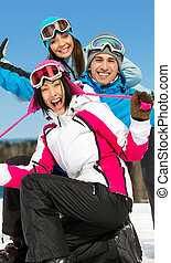 Group of smiley skier friends