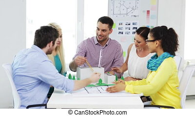group of smiling architects working in office