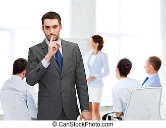 group of smiling businessmen making hush sign - business, ...