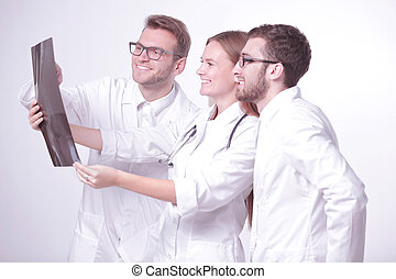 group of smiling doctors discussing x-rays .isolated on white