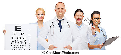 group of smiling doctors with eye chart - medicine,...