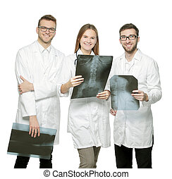 group of smiling doctors with x-rays.isolated on white