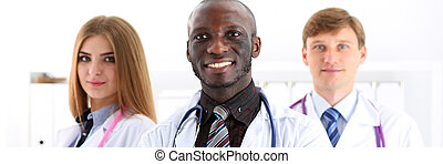 Group of smiling friendly medicine doctors