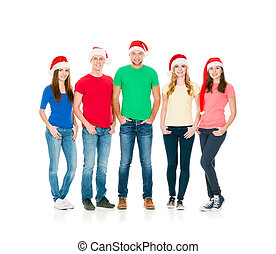 Group of smiling friends in Christmas hats