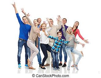 group of smiling people having fun