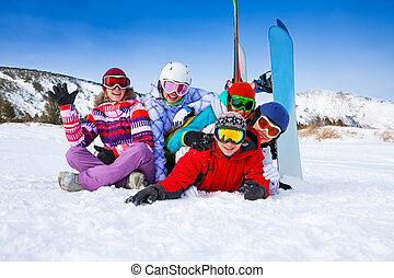 Group of smiling snowboarders