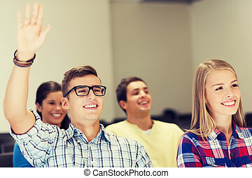 group of smiling students in lecture hall - education, high ...