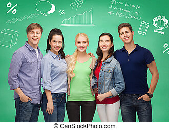 group of smiling students over green board
