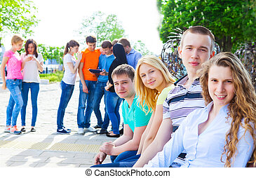 Group of smiling teenagers outdoors