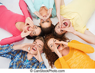 group of smiling teenagers - friendship, youth, gesture and...