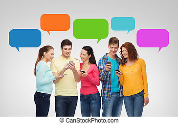 group of smiling teenagers with smartphones - friendship,...