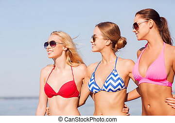 group of smiling young women in sunglasses - summer...