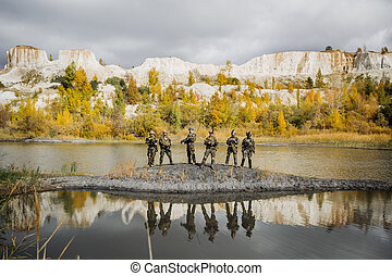 group of solders standing and looking at the camera