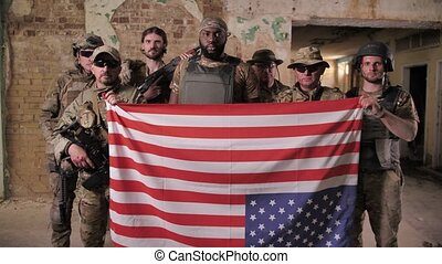Group of soldiers posing with USA flag upside down - Squad ...