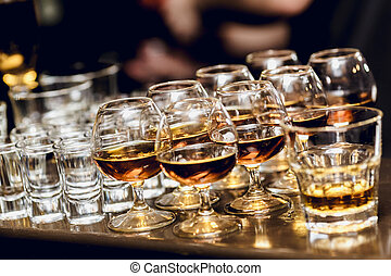 Group of spirits in brandy snifters - Various alcohol drinks...