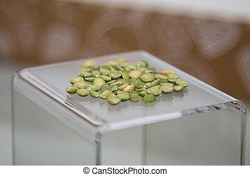 Group of Split Green Peas on a Transparent Pedestal