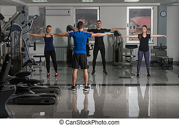 Group Of Sportive People In A Gym Training