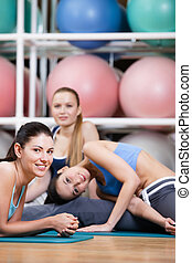 Group of sportive women have a rest