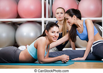 Group of sportswomen rest in the fitness class