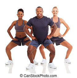 group of sporty people exercising