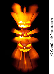 Group of stacked Halloween Jack o Lanterns with black background