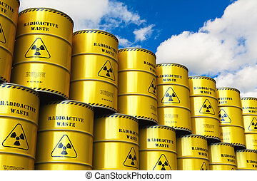 Group of stacked yellow drums with radioactive waste against blue sky