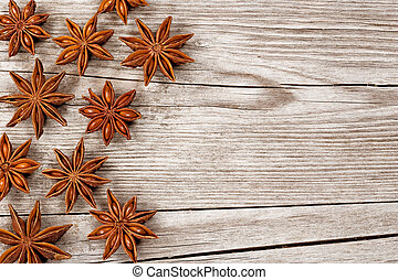 star anise over wooden table