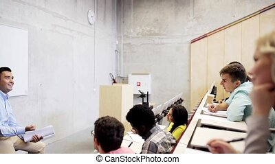 group of students and teacher in lecture hall