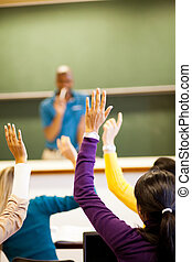 group of students arms up in classroom